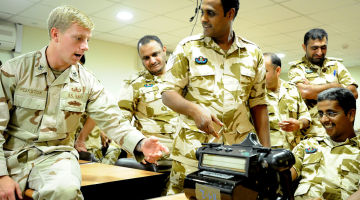 1280px-US_Navy_111115-N-RP435-143_Explosive_Ordnance_Disposal_1st_Class_Carey_Peekstock_shows_Royal_Bahrain_Army_explosive_ordnance_technicians_a_handheld