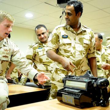 1280px-US_Navy_111115-N-RP435-143_Explosive_Ordnance_Disposal_1st_Class_Carey_Peekstock_shows_Royal_Bahrain_Army_explosive_ordnance_technicians_a_handheld