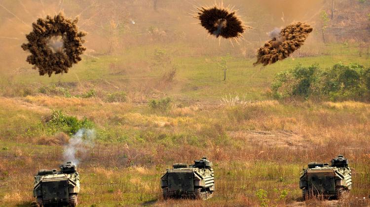 1280px-Amphibious_Assault_Vehicles_fire_smoke_grenades